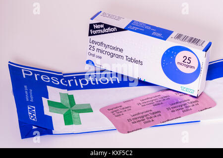 Levothyroxine medication (hormone replacement tablets) to treat an underactive thyroid gland - also called low thyroid - Stock Photo