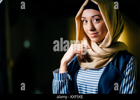 pretty muslim girl in hijab in cafe - Stock Photo
