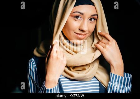 pretty muslim girl in hijab in cafe - Stock Photo