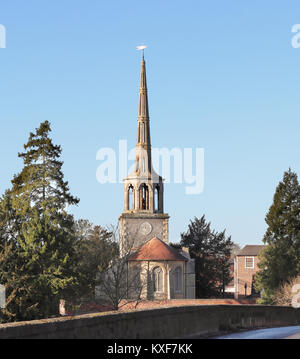 St Peter's Church viewed from a bridge over the river Thames at Wallingford against a clear blue winter sky - Stock Photo