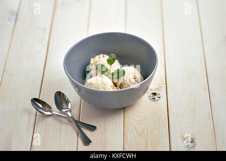 Vanilla ice cream in blue bowl - Stock Photo