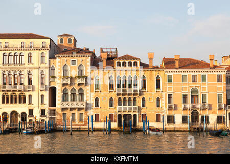 Sunset on the Grand Canal, San Marco, Venice, Italy  with Palazzos Manolesso, Contarini Fasan and Venier Contarini - Stock Photo