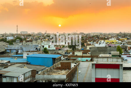 Densely populated area of Ahmedabad as seen from the Ahmedabad - Vadodara Expressway during sunset. - Stock Photo
