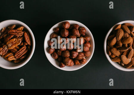 Overhead view of dried fruits in bowls on table - Stock Photo