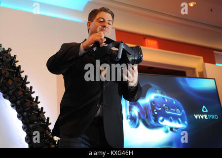 Las Vegas, USA. 08th Jan, 2018. America's HTC chairman Daniel O'Brien holding the special glasses Vive Pro for the - Stock Photo