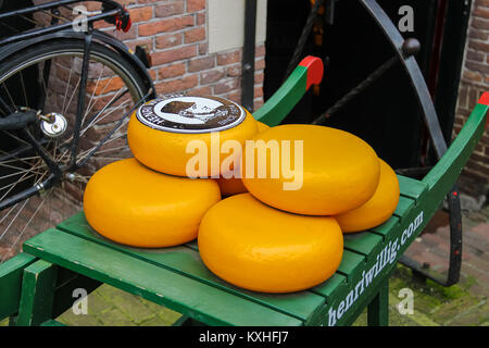 Amsterdam, the Netherlands - October 03, 2015: Dutch cheese on traditional wooden barrow in city centre - Stock Photo