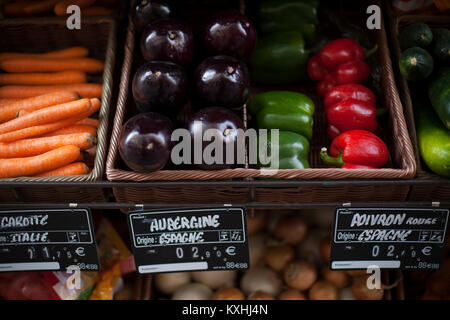 Market stall with aubergines, carrots, pepper, zucchini in Provence, France - Stock Photo
