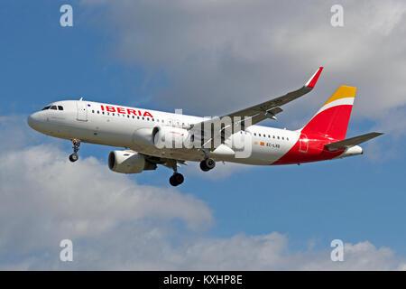 Iberia Airbus A320-216 EC-LXQ landing at London Heathrow. - Stock Photo