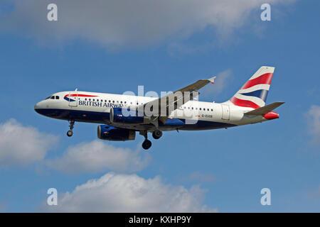 British Airways Airbus A319-131 G-EUOE landing at London Heathrow. - Stock Photo