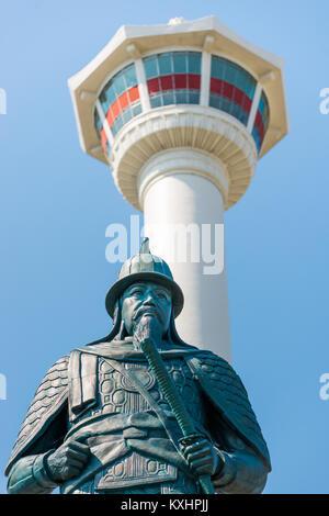 Busan Tower and Statue Admiral Yi Sun-shin in Yongdusan Park, South Korea. - Stock Photo