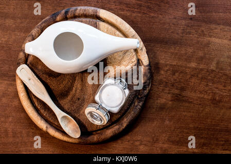 neti pot, ayurvedic system for cleaning nose with water and pink salt from Hymalaia, set with towel, pink hymalaian - Stock Photo