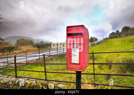 Royal Mail post box in a rural location, UK - Stock Photo