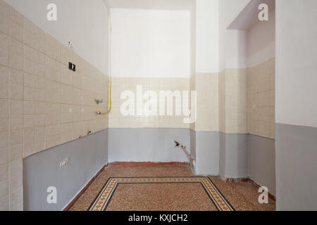 Empty kitchen interior with tiled floor and part of the wall - Stock Photo