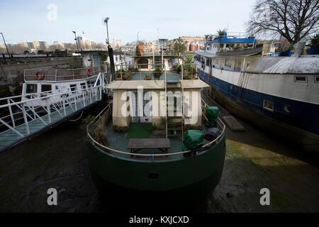 Tideway Village, houseboat community moored next to Battersea Power Station, Nine Elms , London, Greater London, - Stock Photo