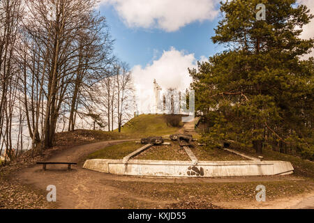 Remains of concrete Three crosses torn down in 1950 by soviets and a new monument of  Three crosses placed in 1989. - Stock Photo