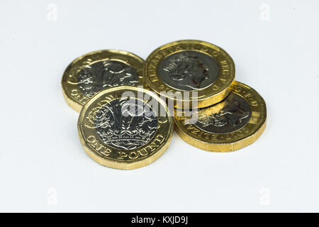 New one pound coins isolated in white background. - Stock Photo