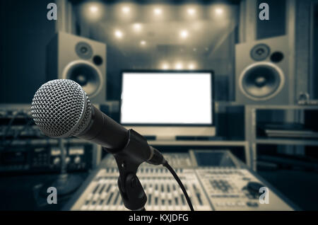 Microphone over the Abstract blurred photo of music studio recording room background, musical concept - Stock Photo