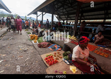 Wamena, Indonesia, People are at the lokal market of Wamena in Baliem Valley, Papua New Guinea. - Stock Photo