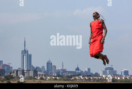 Masai warrior jumping in mid air during traditional dance, Nairobi, Kenya, Africa - Stock Photo