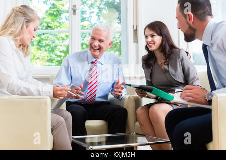 Businesspeople having discussion in office - Stock Photo