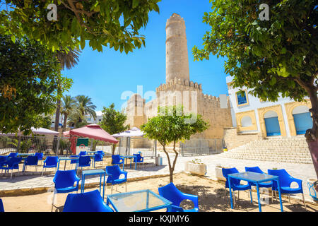 Cityscape with street cafe and view of ancient fortress in Sousse. Tunisia, North Africa - Stock Photo