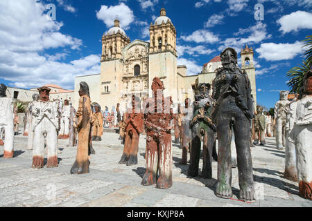 OAXACA, MEXICO - MARCH 7th, 2012: Sculpture art installation in front of the facade of the Church of Santo Domingo - Stock Photo