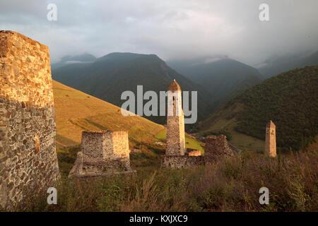 Golden sunset in Chechen/Ingush mountains, Erzi medieval architecture, North Caucasus - Stock Photo