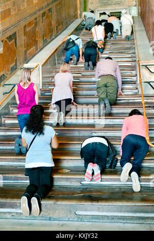Climbing the holy Scala Sancta Stairs, Rome, Italy - Stock Photo