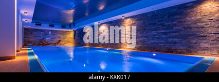Luxury indoor swimming pool in modern hotel spa, panorama - Stock Photo