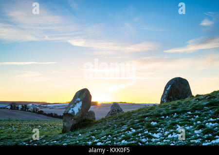 West Kennet Long Barrow in the winter at sunrise. Neolithic chambered tomb. West Kennet, Wiltshire, England - Stock Photo