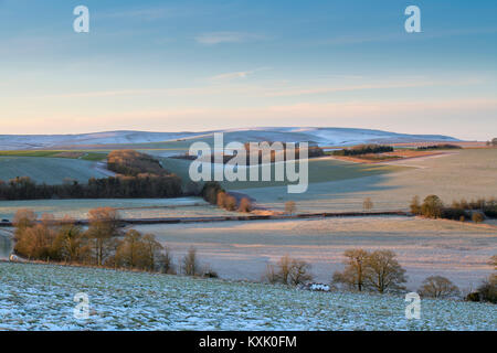 Wiltshire countryside looking over to West Kennet in the december snow, Wiltshire, England - Stock Photo