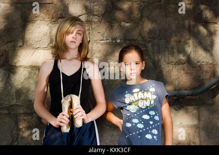 Two young girls looking at the camera - Stock Photo