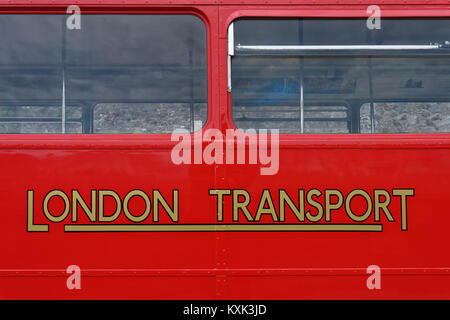 The iconic old logo of London Transport on the side of a Routemaster bus. - Stock Photo