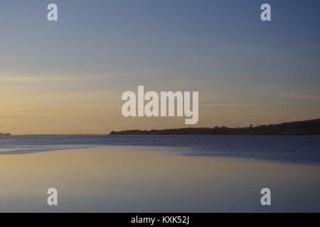 Sunrise over the Exe Estuary at High Tide from Topsham. Devon, UK. January, 2018. - Stock Photo