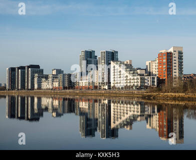 View of Glasgow Harbour modern property development with many high-rise modern riverside apartment buildings in - Stock Photo