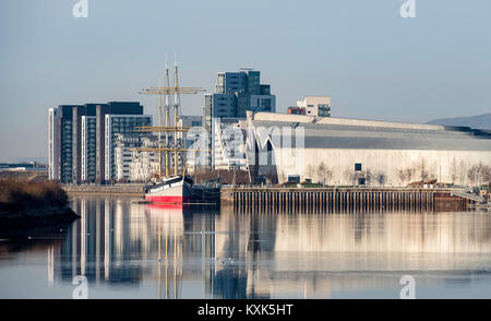 View of Riverside Museum beside River Clyde home of Glasgow Transport Museum with Glenlee ship moored in front in - Stock Photo