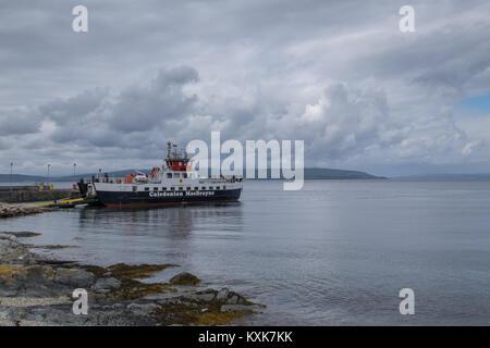 Caledonian MacBrayne ferry the MV Loch Tarbert moored at Lochranza. MV Loch Tarbert runs between Lochranza and Claonaig - Stock Photo