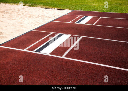 Broad Jump area with sand  in detail in summer - Stock Photo