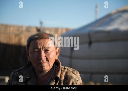 Middle age old man portrait Mongolia ger camp Ulan Bator morning sun rising - Stock Photo