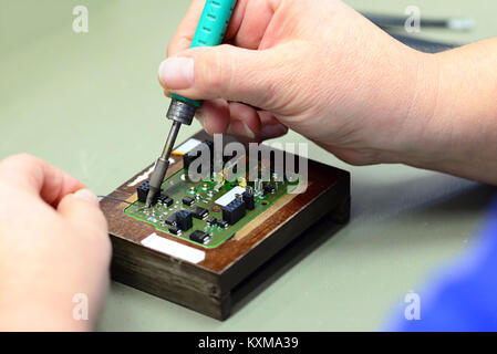 production and assembly of microelectronics in a hi-tech factory - Stock Photo