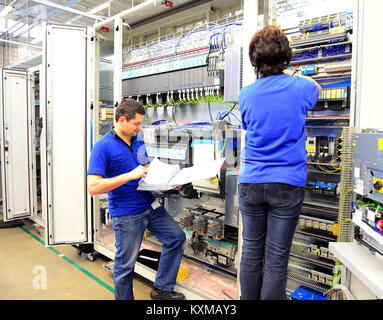 group worker - production and assembly of microelectronics in a hi-tech factory - Stock Photo