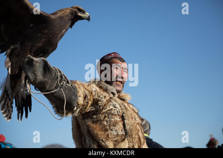 Golden eagle hunter Kazakh eagle festival Bayan Ölgii Ulgii Mongolia - Stock Photo