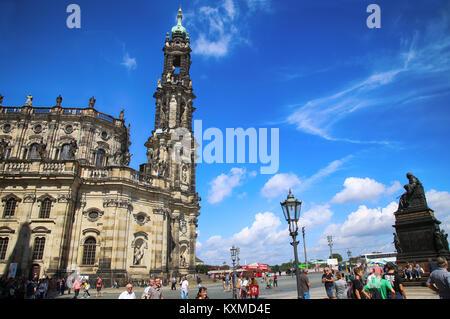 DRESDEN, GERMANY – AUGUST 13, 2016: Tourists walk and visit on Schlossplatz, majestic view on Katholische Hofkirche - Stock Photo