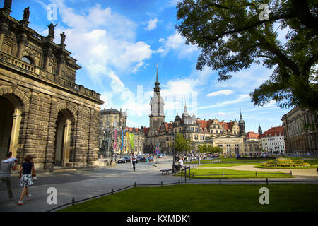 DRESDEN, GERMANY – AUGUST 13, 2016: Tourists walk on Theaterplatz street and majestic view on  Saxony Dresden Castle - Stock Photo