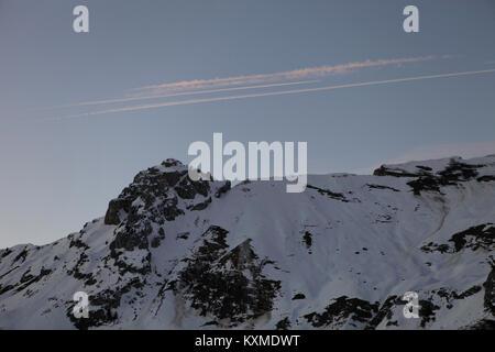 Cloud over Le Buclon, Snowed mountain pic in Le Chinaillon, Le Grand Bornand, Haute Savoie, French Alps. - Stock Photo