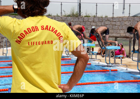 Portugal, Algarve, Monchique, 09.06.2015 Lifeguard watching the people making sure the swimmers are safe in a Monchique - Stock Photo