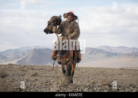 Golden eagle hunter Kazakh eagle festival Bayan Ölgii Ulgii - Stock Photo