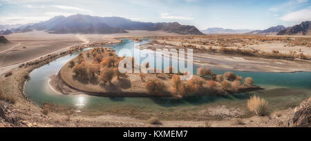 Green river bank yellow leafs fall golden hour calm stream Mongolia panorama - Stock Photo