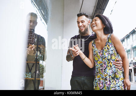 Multi ethnic hipster couple window shopping,Shanghai French Concession,Shanghai,China - Stock Photo
