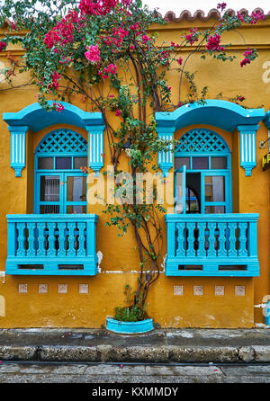 typical colorful facades with balconies and flowers of houses in Cartagena de Indias, Colombia, South America - Stock Photo